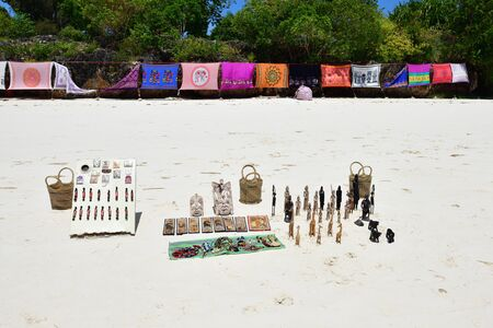 Kendwa, Zanzibar - October 3, 2019: African souvenirs sold on on the Kendwa beach.Tanzania, Africa Редакционное