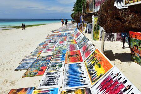 Kendwa, Zanzibar - October 3, 2019: African painting sold on the Kendwa beach.Tanzania, Africa Фото со стока - 137813018