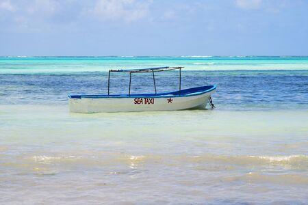 Sea taxi boat moored in blue water, Paje beach, Zanzibar, Tanzania. Africa
