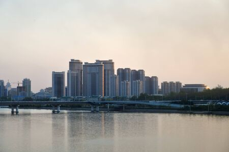 City view and Taedong River at sunset. View on the new Mansudae residential district