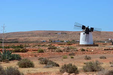 Windmill with broken wing. Fuerteventura, countryside landscape. Spain