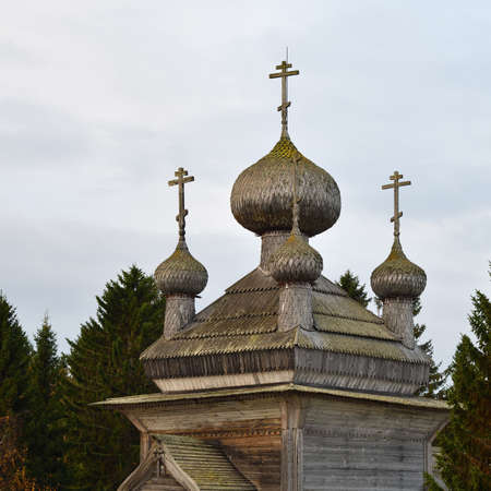 Russia. Karelia. Five-headed crown of the Ancient Orthodox Peter and Paul wooden Church on the shore of White Sea in pomor village Virma. Built in 1625