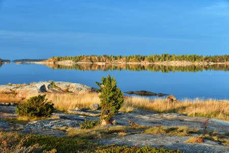 Beautiful landscape of the White Sea at sunrise. Onega Gulf, Karelia, Russia. The littoral zone at high tide