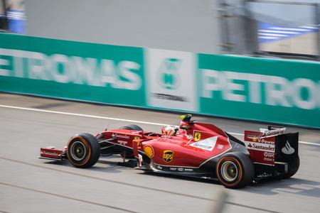 SEPANG - MARCH 30: Kimi Räikkönen of Scuderia Ferrari Team at 2014 Formula 1 Petronas Malaysia Grand Prix Race Day at Sepang circuit on March 30, 2014 in Sepang, Malaysia.