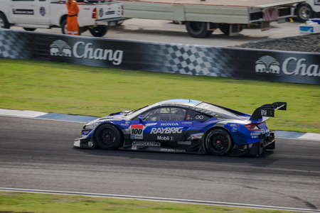 takashi: BURIRUM, THAILAND - OCTOBER 5 : Takashi Kogure andHideki Mutoh of TEAM KUNIMITSU in GT500 Races at 2014 AUTOBACS SUPER GT Round7 BURIRAM UNITED SUPER GT RACE on October 5, 2014 in Burirum, Thailand.
