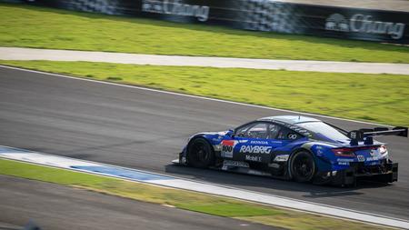 takashi: BURIRUM, THAILAND - OCTOBER 5 : Takashi Kogure andHideki Mutoh of TEAM KUNIMITSU in GT500 Races at 2014 AUTOBACS SUPER GT Round7 BURIRAM UNITED SUPER GT RACE on October 5, 2014 in Burirum, Tha