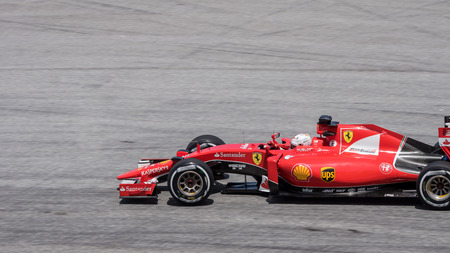 vettel: SEPANG - MARCH 27: Sebastian Vettel of Scuderia Ferrari at 2015 Formula 1 Petronas Malaysia Grand Prix Second Practice Session at Sepang circuit on March 27, 2015 in Sepang, Malaysia.
