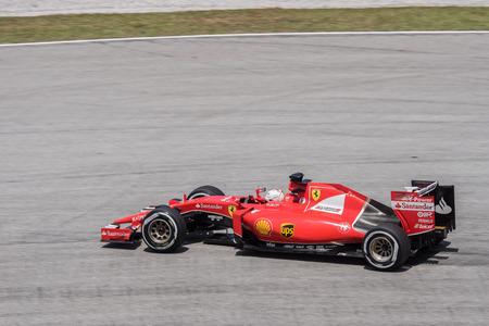 vettel: SEPANG - MARCH 27: Sebastian Vettel of Scuderia Ferrari at 2015 Formula 1 Petronas Malaysia Grand Prix Second Practice Session at Sepang circuit on March 27, 2015 in Sepang, Malaysia.