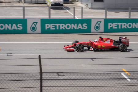 vettel: SEPANG  MARCH 29: Sebastian Vettel of Scuderia Ferrari at 2015 Formula 1 Petronas Malaysia Grand Prix Race Day at Sepang circuit on March 29 2015 in Sepang Malaysia.