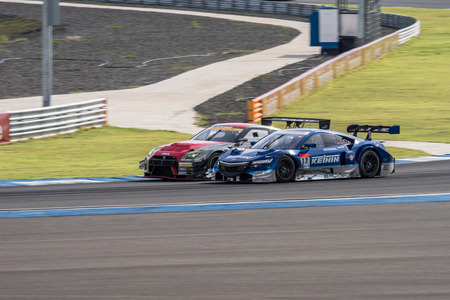 buriram: BURIRUM, THAILAND - JUNE 21 : Koudai Tsukakoshi of KEIHIN REAL RACING Versus  Katsumasa Chiyo of GAINER in Super GT Final Race 66 Laps at 2015 AUTOBACS SUPER GT Round 3 BURIRAM SUPER GT RACE on June 21, 2015 in Burirum, Thailand.