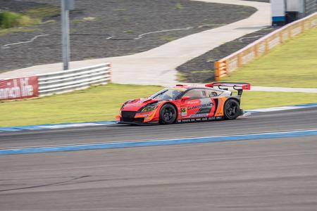 takashi: BURIRUM, THAILAND - JUNE 21 : Takashi Kobayashi of AUTOBACS RACING TEAM AGURI in Super GT Final Race 66 Laps at 2015 AUTOBACS SUPER GT Round 3 BURIRAM SUPER GT RACE on June 21, 2015 in Burirum, Thailand.