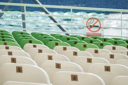 smocking: Stock Photo - stadium seats no smocking selective focus