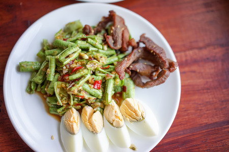 long bean: Stock Photo - Long Bean Salad with Cooked Eggs and Fried Pork