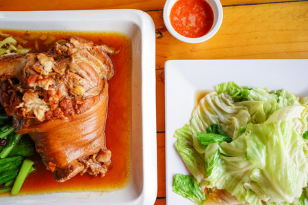 oily: Stock Photo - Stewed pork leg and stir-fried cabbage with fish sauce