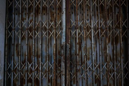 Stock Photo - Vintage rust metal door older slide gate