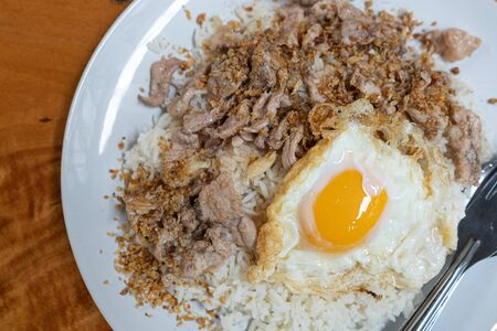 Stock Photo - Fried pork with garlic over rice peper with fried egg