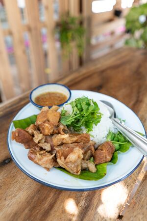 Bak kut teh, pork bone with Chinese herbs soup on top rice with chilli sauce