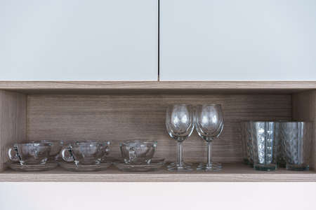 Row of clean Coffee and wine glasses on shelf. Stock Photo