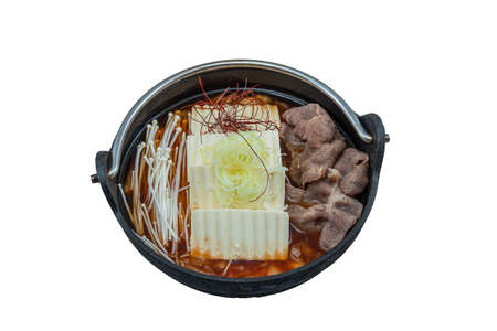 Kimchi Jjigae or Kimchi Soup with Tofu and Egg, Korean Kimchi Stew - Korean Food Traditional Style served in hot pot isolated on white background