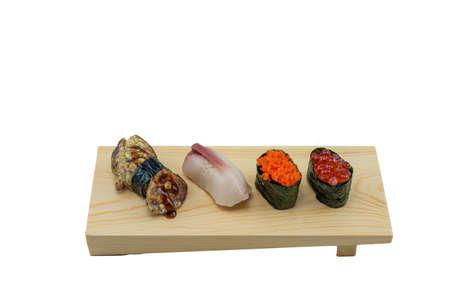Japanese Food : Mixed Sushi on Wooden Board, Foie Gras, Hamachi, Tobiko and Ikura  on White Background