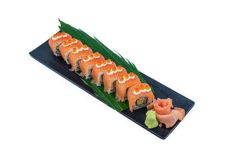 Salmon roll with salmon, smoked eel, avocado, cream cheese on black background. Sushi menu - Japanese Food Style on White Background