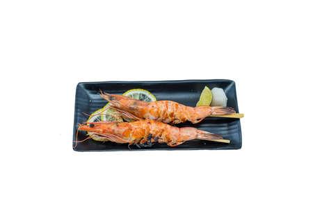 Japanese Food : Sweet Shrimp Grilled (Ama Ebi) on Black Dish with Lemon on White Background