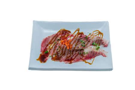 Japanese Food : Sushi Wagyu Beef with Wweet Shoyu Sauce on top with Ebiko Shrimp Eggs on White Background