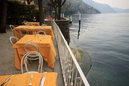 lake como: tables set along the Lake Como