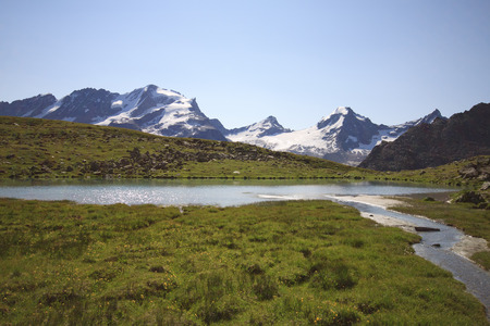 alluvial: Plan Borgno lake, Valsavaranche  In the background the Gran Paradiso Stock Photo