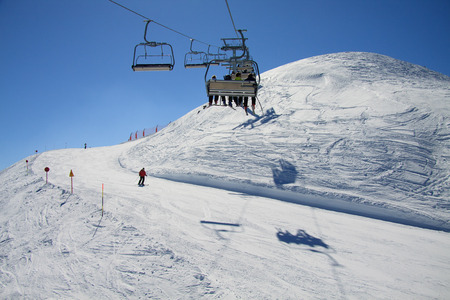 skiers: Skiers on chairlift - Paganella