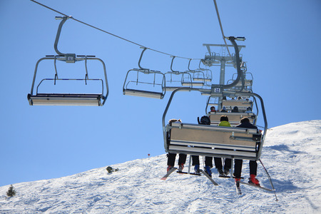 Skiers on chairlift - Paganella