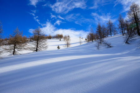 winter landscape, climbing towards the Foisc, in the Lepontine Alps (Switzerland)