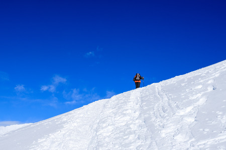 mountaineers uphill with snowshoes towards the Foisc lace, in the Leonine Alps (Switzerland)
