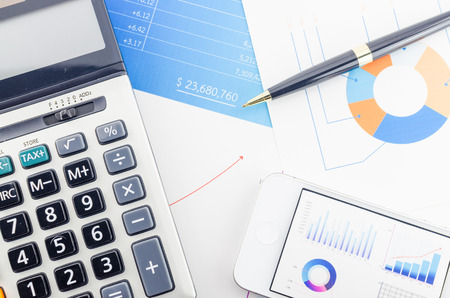 financial security: Graphs and Calculator Stock Photo
