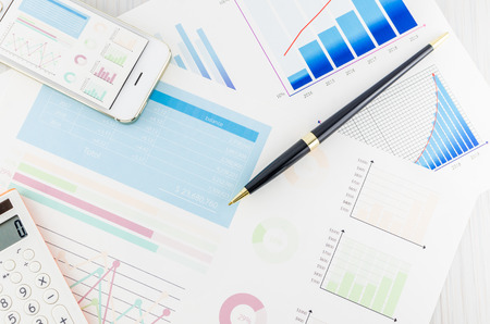 smart investing: Graphs and Calculator Stock Photo