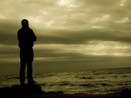 Mensch und Sonnenuntergang Standard-Bild