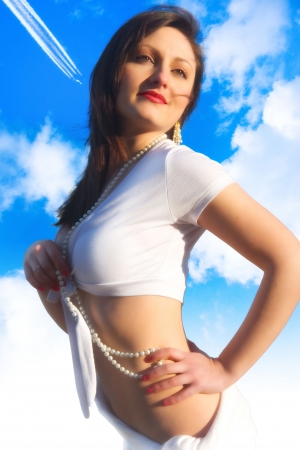 clowds: Beautiful woman againts blue sky