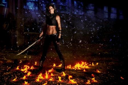 warrior pose: warrior girl Stock Photo