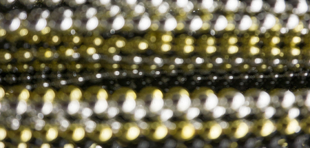 Silver, gold and black blurry beads horizontal background
