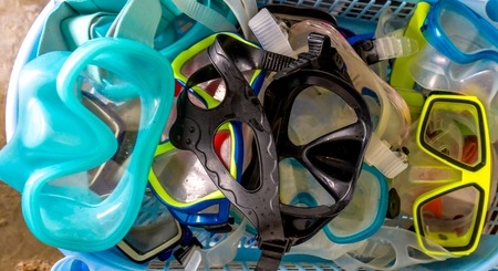 Bunch of diving mask / snorkeling goggles for diving under water Standard-Bild