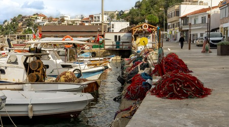 Fishing harbour of the rural touristic town of Karaburun, Izmir. Turkey. Nets and boats