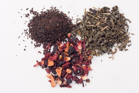 free radicals: piles of dry green, black and fruit tea leaves