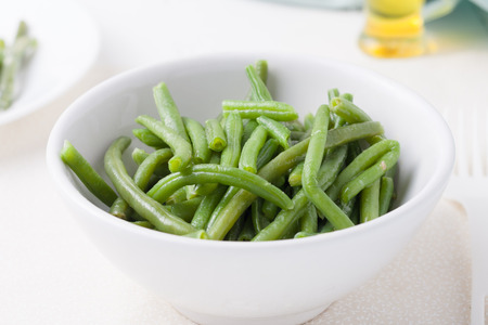 blanch: cooked string beans in a white bowl
