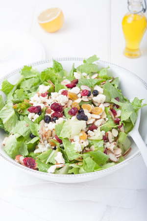 romaine: Salad in white bowl. Ingredients include romaine lettuce, gorgonzola cheese and almonds Stock Photo