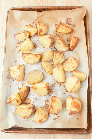 quartered: oven roasted potatoes on a baking sheet