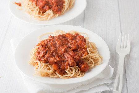 spagetti pasta with meat tomato sauce on white background