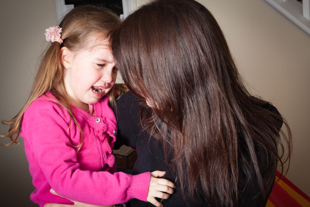comforted: crying little girl being comforted by her mother, great parenting image