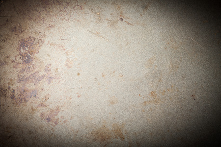 vignetted: burnt metal background, vignetted, with space for text or image