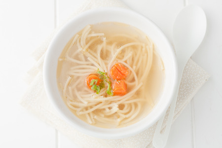homemade chicken noodle soup with carrots, top view Standard-Bild