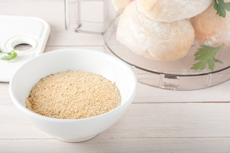 homemade breadcrumbs with spices and herbs in white bowl